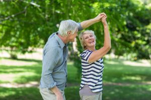 older couple dancing outside