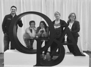 Team posing in front of Ohio Dental Association Sign