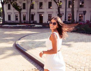 woman wearing white dress and sunglasses
